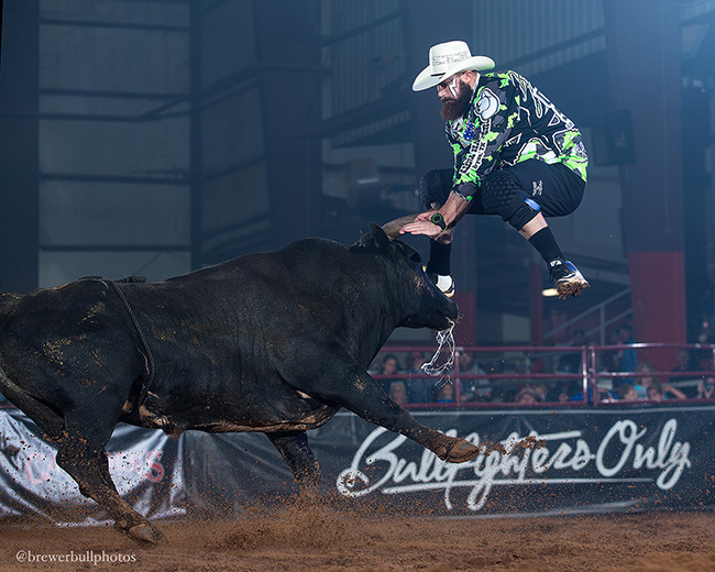 Weston Rutkowski jumps Rockin' B & Magnifica Fighting Bulls' Mess Up The Ranch during Saturday's championship round of the Bullfighters' Only Ada Invitational. Rutkowski won the title with an 88-point bout with that bull. (TODD BREWER PHOTO)