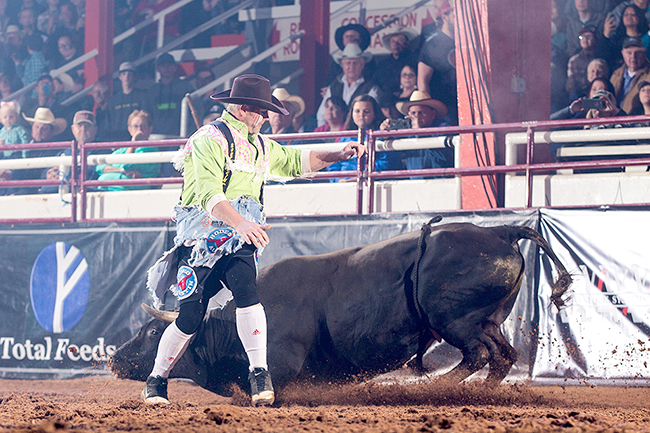 "Lance Brittan performs a ""cape"" maneuver during his bout at the Bullfighters Only Ada (Okla.) Invitational on April 22. Brittan, the 1999 Wrangler Bullfights Tour world champion, has returned to the game he loves at age 42. (TODD BREWER PHOTO)"