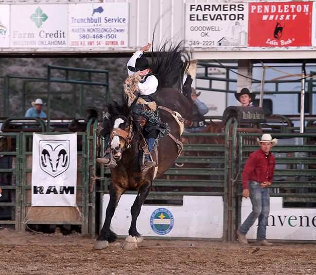 Rusty Wright rides Powder River Rodeo's Look Again for 87 points to take the lead at the Guymon Pioneer Days Rodeo. (JAMES PHIFER PHOTO)
