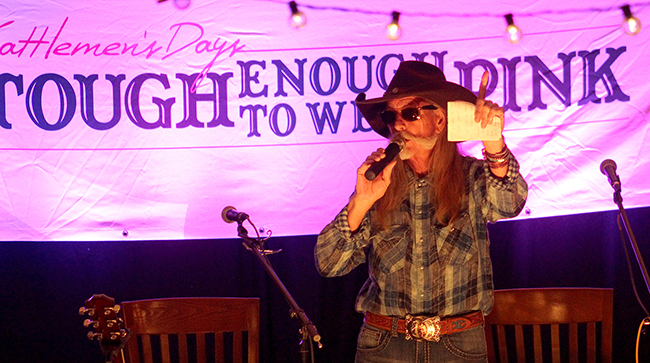 Dean Dillon visits with the crowd during the Cattlemen's Days Tough Enough to Wear Pink Songwriter Concert and Auction. The event raised more than $300,000 for the grassroots organization, which uses the funds locally.