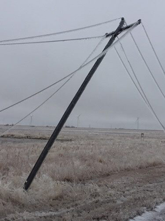 A power pole and lines sag during the January ice storm that rocked Dodge City. (VICTORY ELECTRIC PHOTO)