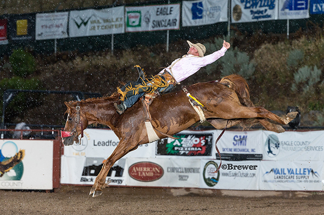 Three-time world champion Will Lowe rides Pete Carr's The Senator on Friday night for 81 points at the Eagle County Fair and Rodeo. (TODD BREWER PHOTO)