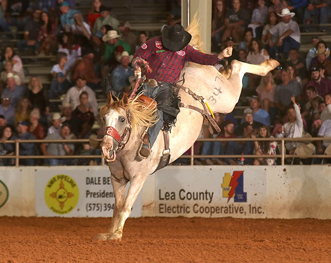 Sterling Crawley rides Pete Carr Pro Rodeo's Miss Molly for 82 points Friday to sit in a tie for third place with his good friend and traveling partner, Dean Wadsworth. (PEGGY GANDER PHOTO)