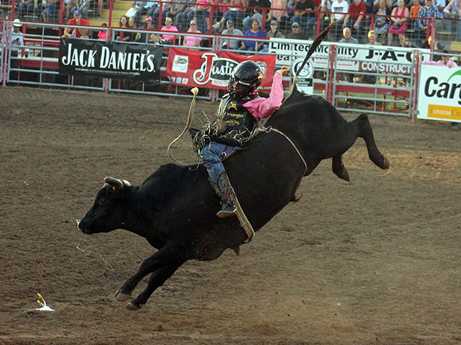 Reigning three-time world champion Sage Kimzey rides 4L and Diamond S Rodeo's Lost Highway for 82.5 points on Saturday night at Dodge City Roundup Rodeo. He finished tied for seventh in the first round and will compete in Sunday's short round.