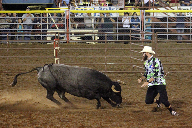 Weston Rutkowski makes a move with the Rockin' B and Magnifica bull called Manchada during Tuesday night's bout. Rutkowski scored 86.5 points to win the Bullfighters Only-Dodge City title.