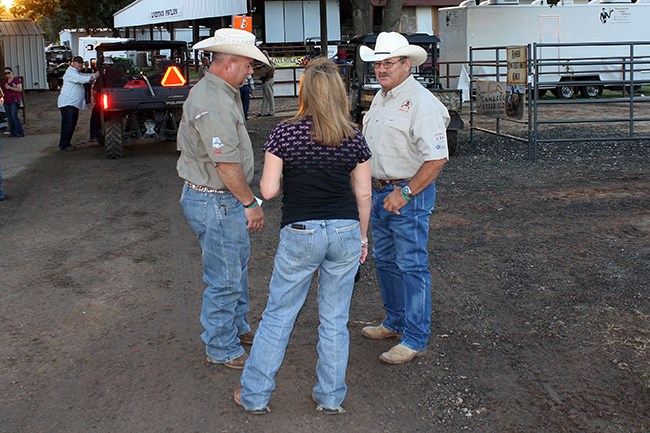Waller County Fair and Rodeo directors visit with a fair-goer during a recent fair. The directors are all volunteer, and they are the ones who handle much of the heavy lifting that makes the fair and rodeo happen each year.
