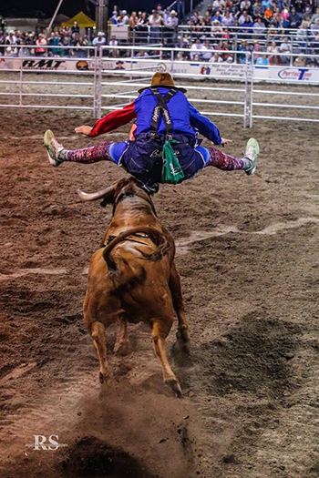 Justin Josey jumps over Miguel Costa's Sid Vicious to start his winning bout at Bullfighters Only-Lewiston this past weekend. (ROSEANNA SALES PHOTO)