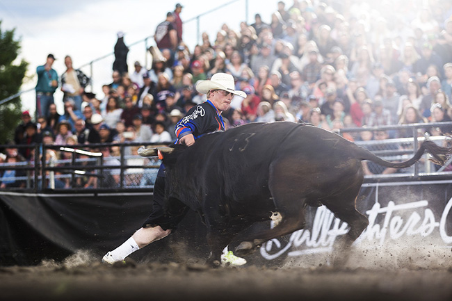 Zach Call battles his bull earlier this year during the FlexFit Invitational in Lewiston, Idaho. He returns to Lewiston this weekend for the Bullfighters Only event in conjunction with the Lewiston Roundup. (TODD BREWER PHOTO)