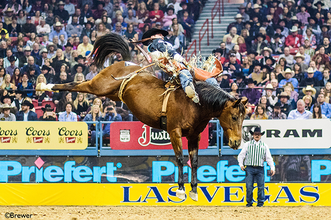 Richmond Champion rides Pete Carr's Fancy Free for 87.5 points to share the second-round victory Friday at the Wrangler National Finals Rodeo. (TODD BREWER PHOTO)