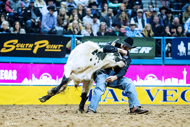 Tyler Pearson wrestled his steer in 4.0 seconds to finish as the runner-up in Round 2, his second straight runner-up finish at the National Finals Rodeo. He has won more than $51,000 over two nights. (TODD BREWER PHOTO)