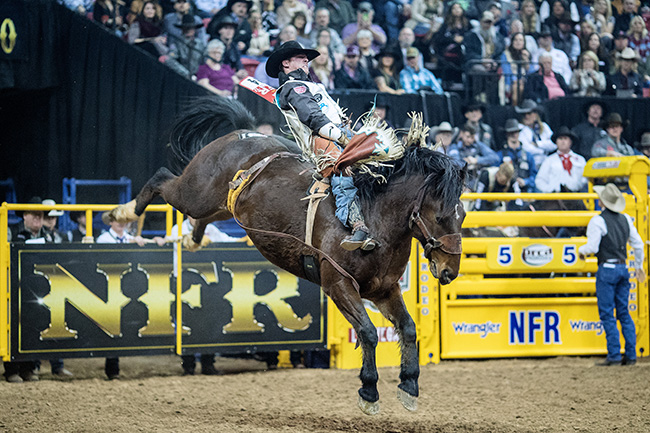 Richmond Champion rides Frontier Rodeo's Full Baggage for 89.5 points to finish second in the third go-round Saturday night at the Wrangler National Finals Rodeo. (TODD BREWER PHOTO)
