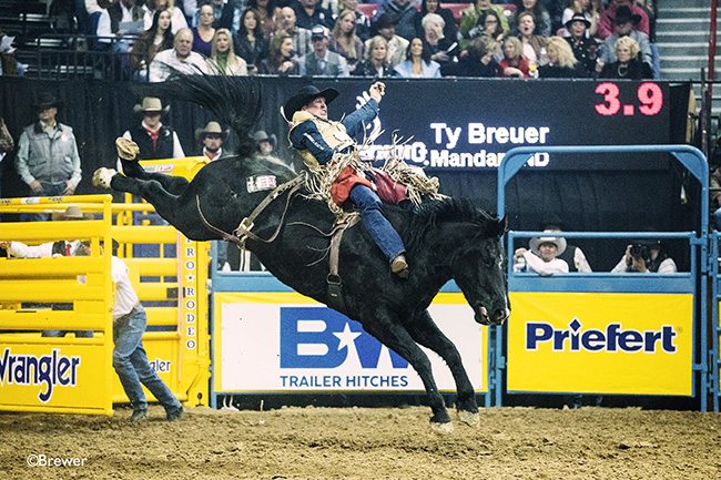 Ty Breuer spurs Four Star Rodeo's Big Star for 90.5 points to win Sunday's fourth go-round of the Wrangler National Finals Rodeo. It was Breuer's first go-round victory in his three appearances in Las Vegas. (TODD BREWER PHOTO)