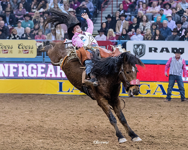 Richmond Champion rides Pete Carr Pro Rodeo's Dirty Jacket for 88 points Monday to finish in a tie for second place during the fifth round of the Wrangler National Finals Rodeo. (TODD BREWER PHOTO)