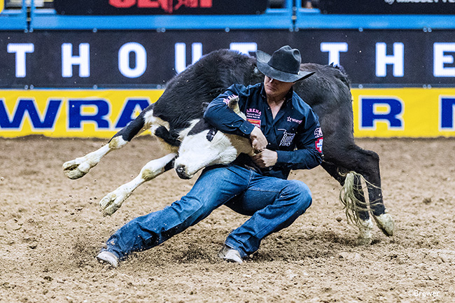 J.D. Struxness turns his steer during Monday's fifth round of the Wrangler National Finals Rodeo. He stopped the clock in 4.1 seconds and finished fourth in the round. (TODD BREWER PHOTO)
