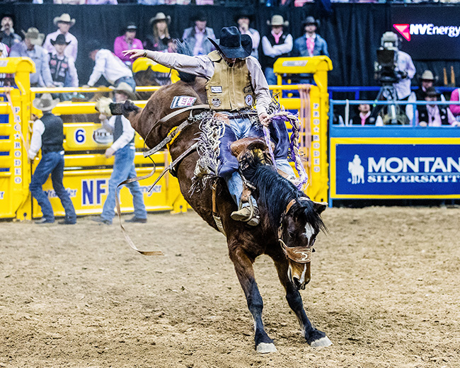Hardy Braden rides Powder River Rodeo's Rich N Fancy for 85.5 points to finish in a tie for sixth place Monday during the fifth round of the Wrangler National Finals Rodeo. (TODD BREWER PHOTO)