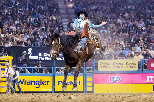 Richmond Champion rides Hi Lo Pro Rodeo's Wilson Sanchez for 86.5 points Saturday night to finish in a tie for fourth place to close out his incredible Wrangler National Finals Rodeo. (TODD BREWER PHOTO)
