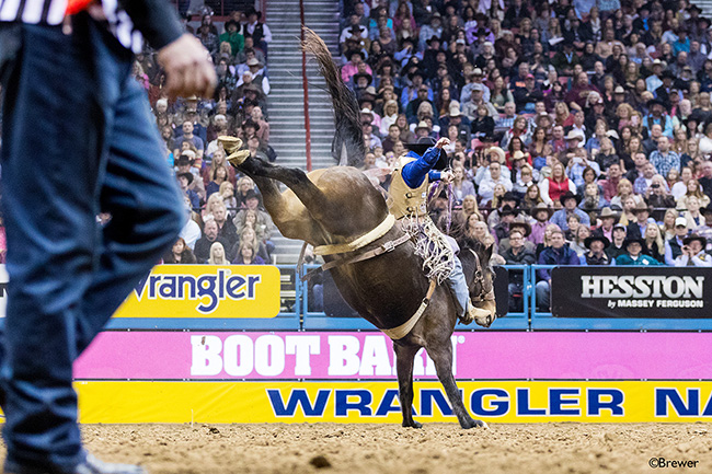 Hardy Braden rides Andrews Rodeo's Fire Lane for 82 points to finish off his first Wrangler National Finals Rodeo with his eighth go-round check. He finished second in the average and earned more than $160,000 at the NFR. (TODD BREWER PHOTO)