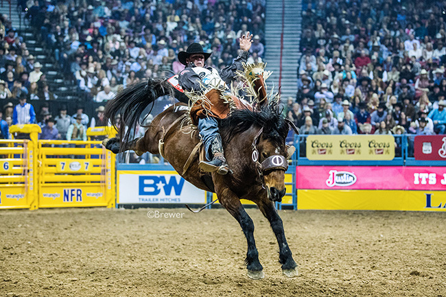 Richmond Champion rides Cervi Championship Rodeo's Control Freak for 84 points to finish in a tie for sixth place in Sunday's fourth round of the Wrangler National Finals Rodeo. (TODD BREWER PHOTO)