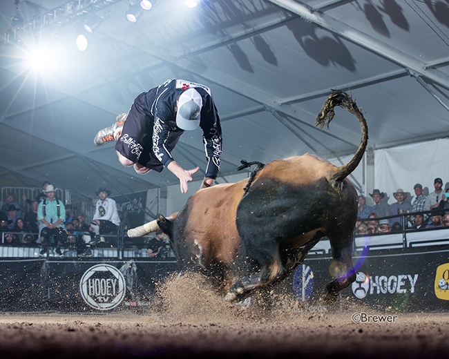 Weston Pender kicks off his fight Friday with a front flip. He won his round and advanced out of the first day of qualifying for the Bullfighters Only Las Vegas Championship. (TODD BREWER PHOTO)