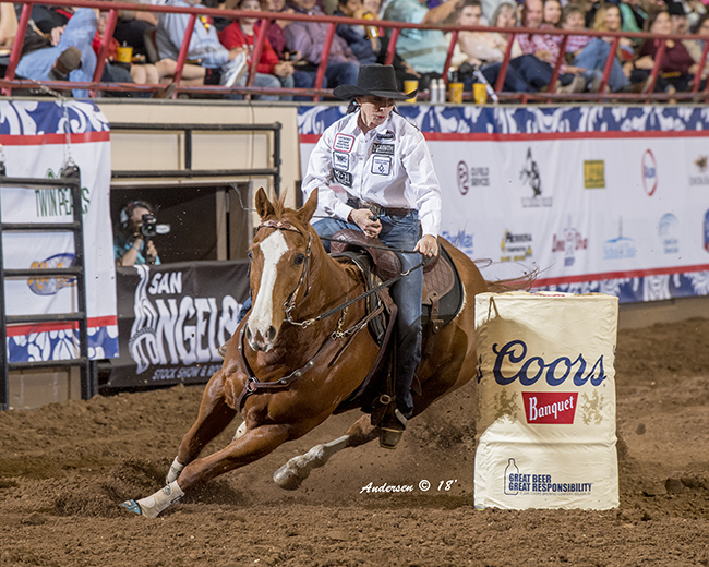 Teri Bangart circles the cloverleaf pattern in 14.21 seconds to take the lead at the San Angelo Stock Show and Rodeo. (RIC ANDERSEN PHOTO)