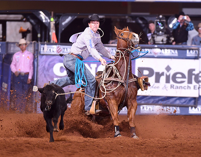 Jordan Ketscher finishes off a tie-down roping run during Sunday's final round of the CINCH Timed Event Championship. Ketscher became the 14th cowboy in the 34-year history of the contest to win the title. (JAMES PHIFER PHOTO)