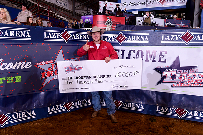 Myles Neighbors of Benton, Ark., poses with his check for winning the Jr. Ironman Championship. (JAMES PHIFER PHOTO)