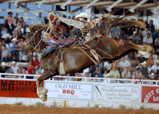 Two-time world champion saddle bronc rider Cody Wright rides Pete Carr's Deuces Wild  in Pecos a few years ago. This will be the 136th year for the West of the Pecos Rodeo, the World's Oldest Rodeo. (ROBBY FREEMAN PHOTO)