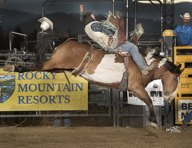 J.C. Hester rides Cervi Championship Rodeo's Dream Machine for 86.5 points Sunday to take the lead at the Rooftop Rodeo in Estes Park, Colo. (PHOTO BY GREG WESTFALL)