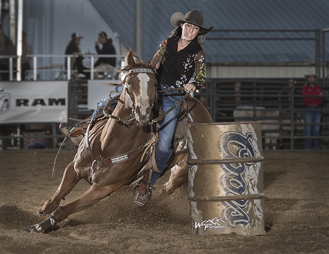 Sydni Blanchard and her horse, Heart, round the second barrel en route to their arena-record 17.21-second run Monday night at Rooftop Rodeo. (PHOTO BY GREG WESTFALL)
