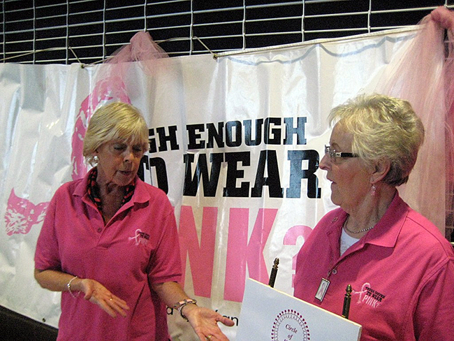 Volunteers man the Tough Enough to Wear Pink booth to help raise money for the Circle of Hope during the Dodge City Roundup Rodeo. (WEBSITE PHOTO)