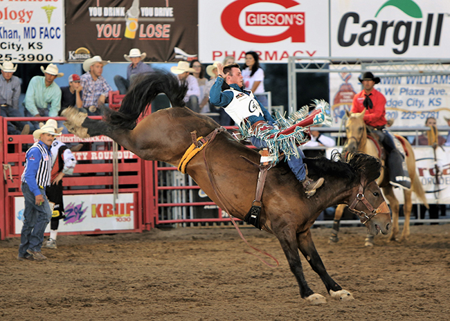 Two-time reigning world champion Tim O'Connell rides Frontier Rodeo's Times Up for 87 points Friday to take the bareback riding lead at the Dodge City Roundup Rodeo. (PHOTO BY DAVID SEYMORE)