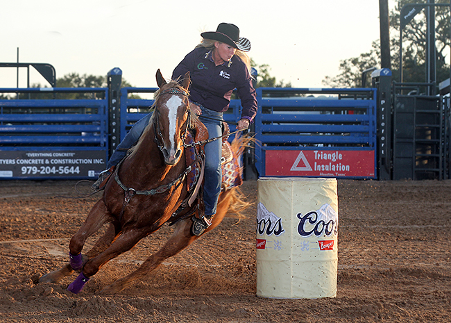Tammy Fischer, a six-time Wrangler National Finals Rodeo qualifier from Ledbetter, Texas, makes a run during the 2017 Austin County Fair and Rodeo. The rodeo committee was awarded one of the WPRA's Justin Boots Best Footing Award for the Texas Circuit in 2017. (PHOTO BY PEGGY GANDER)