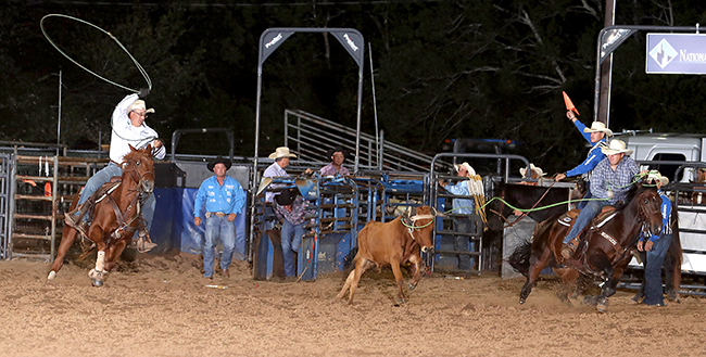 Martin Lucero, left, and Cory Kidd V took the team roping lead at the Austin County Fair and Rodeo after stopping the clock in 4.7 seconds Thursday night. (PHOTO BY PEGGY GANDER)
